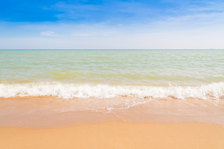 Abstract beach background. Yellow sand, blue sky and calm tropical beach landscape.Exotic nature concept.Location Satheep Thailand.