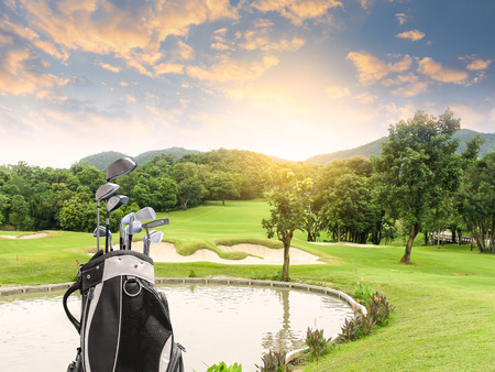 Golf equipment and golf bag on green and golf course as background. Stock Photo