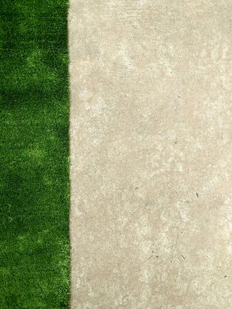 artificial green grass and concrete wall for textured background Stockfoto