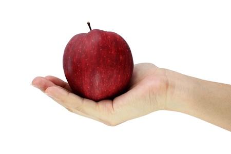 Mano che tiene mela rossa Archivio Fotografico