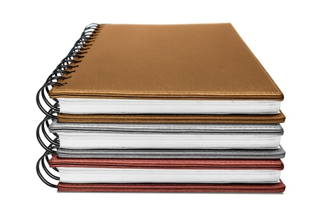 three notebook isolated on white photo