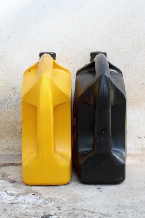 Yellow and black oil container photo