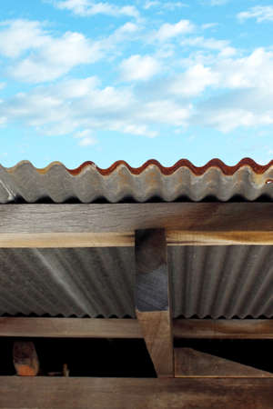 damaged roof: A rusty corrugated roof  iron metal texture Stock Photo