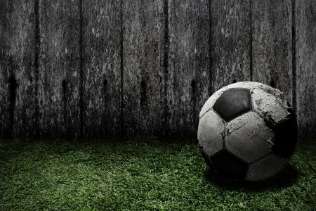 Old football on grass Stock Photo - 14536903