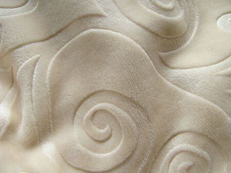 coverlet: Graceful coverlet of beige colour. Photo                                Stock Photo