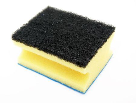 Yellow sponge; bast whisp isolated over white photo