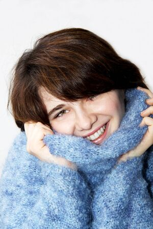 The beautiful girl smiles, in a blue sweater Stock Photo - 6429390