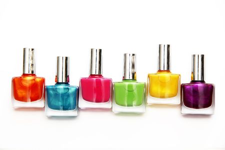 tube top: Group of nail polishes of different colors on white background Stock Photo