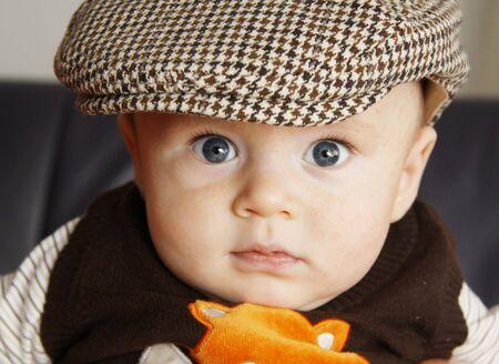 The little boy in a cap photo