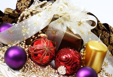 christmas gift in gold box with bow and candle Stock Photo - 8240695