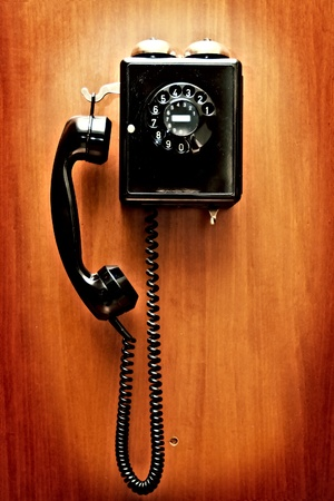 antique booth: Phone hangs on a wall Stock Photo