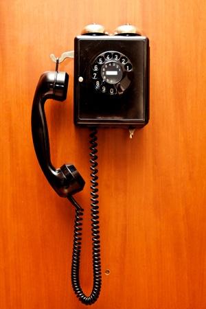Phone hangs on a wall photo