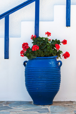 traditional Greek Vase with old door in Santorini, photo