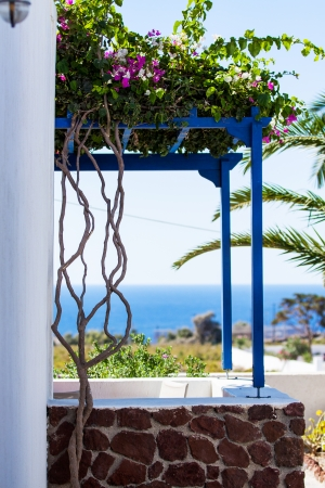Traditional greek door with a great view on Santorini island, Greece  photo