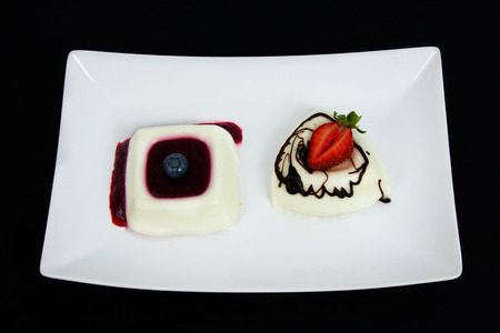 panna cotta with sauce of strawberry and blackberries, photo
