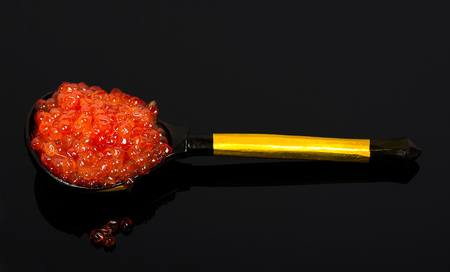 exclusive photo: Red exclusive caviar macro photo isolated on dark background
