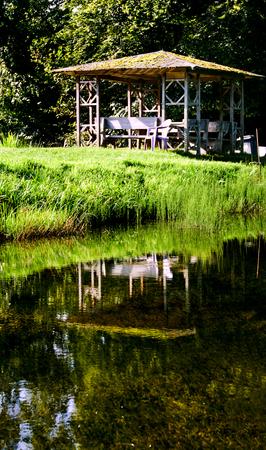 gazebo: wooden gazebo in the lake