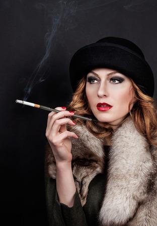 30 s: Retro Woman Portrait. Beautiful Woman with Mouthpiece. Cigarette. Smoking Lady