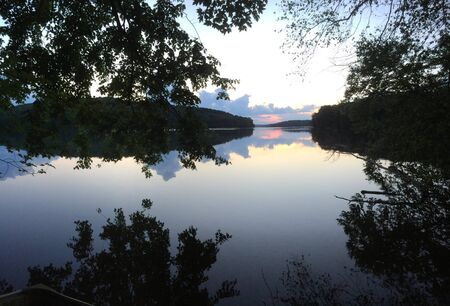 Twilight reflected in the mirror of a clear lake Reklamní fotografie