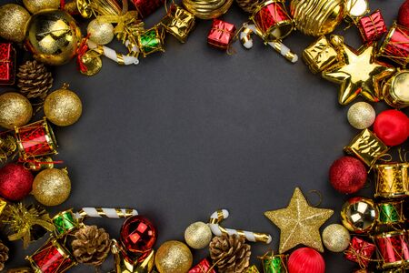 Christmas Decoration Items with Black Background, Gift Box Gold And Red Color Ball Flat lay Top View