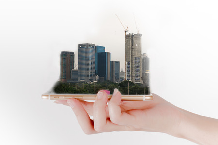 buying time: The hand uses a smartphone or tablet, looking for real estate. Investment concept.