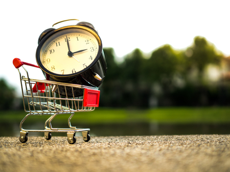 buying time: Close up alarm time on the shopping cart, buying time concept