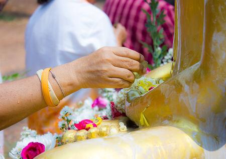songkran: Showering Buddha statue in SongKran festival, Thailand