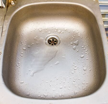 stainless steel kitchen: Empty Stainless Steel Kitchen Sink Stock Photo