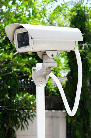 nightvision: Outdoor Camera Housing for Bullet or PTZ CCTV Surveillance Camera System Stock Photo