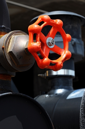 red valves to control flow through pipework   photo