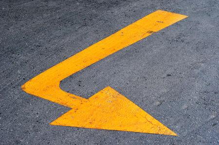 arrow sign on surface of  street