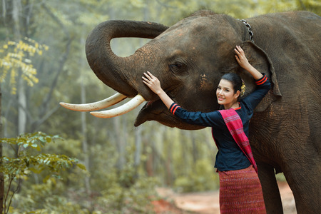 Beautiful woman and elephant with Thai culture traditional ,vintage style Stock Photo