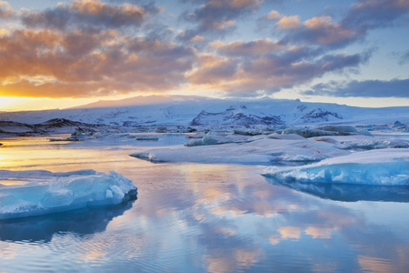 Icebergs in the glacier lake in Iceland Jkulsrln in winter. Photographed at sunset.