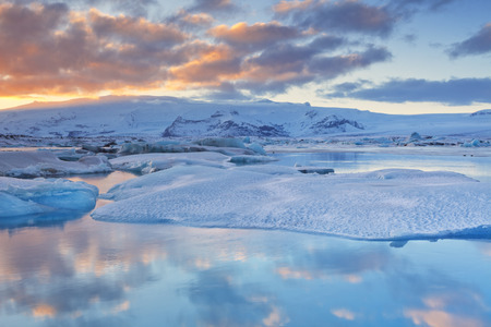 arctic waters: Icebergs in the Jkulsrln glacier lake in Iceland in winter. Photographed at sunset. Stock Photo
