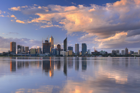 city people: The skyline of Perth, Western Australia at sunset. Photographed from across the Swan River.