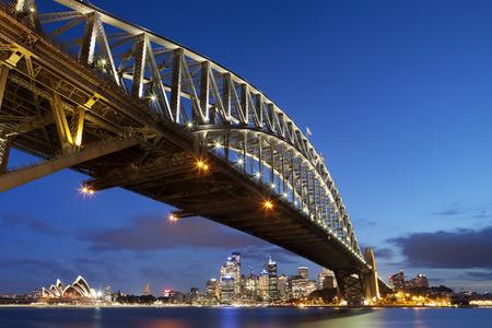 The Harbour Bridge, Sydney Opera House and Central Business District of Sydney. Photographed at dusk. Redakční