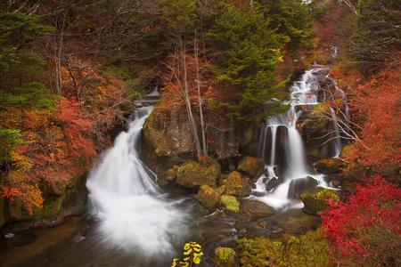 The Ryuzu Falls Ryuzu-no-taki,  near Nikko, Japan surrounded by autumn colours. Reklamní fotografie - 43325838