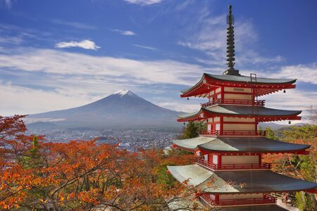 The Chureito pagoda and Mount Fuji Fujisan,  in the background on a bright day in autumn.