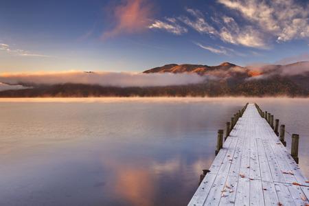 pier: Lake Chuzenji Chuzenjiko,  near Nikko in Japan. Photographed on a beautiful still morning in autumn at sunrise.