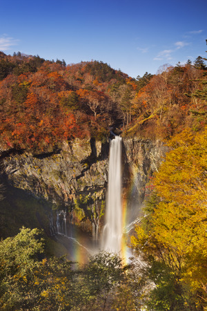 water fall: The Kegon Falls Kegon-no-taki,  near Nikko, Japan surrounded by autumn colours. Stock Photo