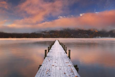 Lake Chuzenji Chuzenjiko,  near Nikko in Japan. Photographed on a beautiful still morning in autumn at sunrise.
