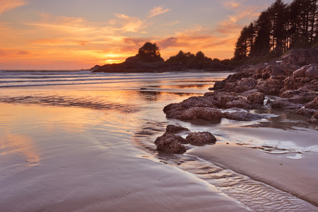 The beach of Cox Bay on Vancouver Island, Canada. Photographed at sunset. Stock Photo