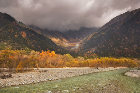 japanese fall foliage: Autumn colours along the Azusa River in Kamikochi National Park  in Japan. Stock Photo