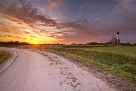 north holland: The church of Den Hoorn on the island of Texel in The Netherlands at sunrise.