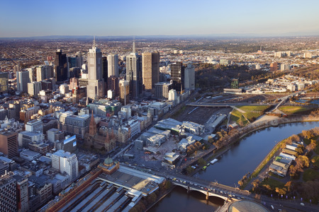 flinders: Downtown Melbourne, Australia with Flinders Street Station in the foreground. Photographed from above at sunset. Stock Photo