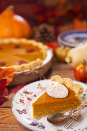 fall leaf: Homemade pumpkin pie on a rustic table with autumn decorations. Stock Photo