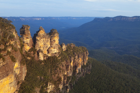 three sisters: The Three Sisters rock formation in the Blue Mountains, New South Wales, Australia. Photographed at sunset. Stock Photo