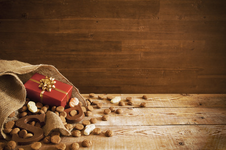 'De zak van Sinterklaas' (St. Nicholas' bag) filled with 'pepernoten', a letter of chocolate and sweets. All part of the traditional Dutch holiday 'Sinterklaas'. Stock Photo