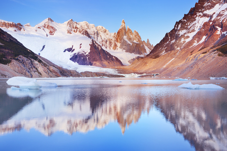 cerro torre: The peaks of Cerro Torre in Argentinian Patagonia reflected in the lake below. Photographed at sunrise.