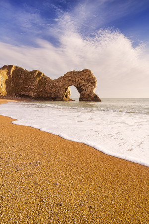 durdle: The Durdle Door rock arch on the Dorset Coast in Southern England on a sunny day. Stock Photo